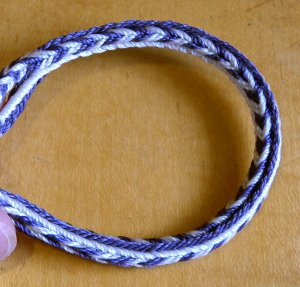 16-loop variation in 2 colors, bonded nylon beading cord