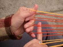 Extend Rd finger thru all L loops except thumb-loop