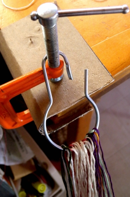 Mounting loops onto a ring for finger loop braiding