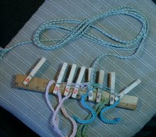 1st half is done, 2nd half has been started, braided down to end of one set of knotted-up loops. to