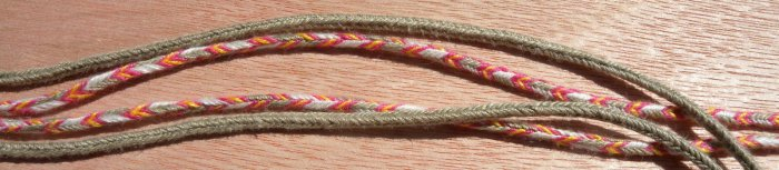 fingerloop braiding, fine linen, well-worn hat strings