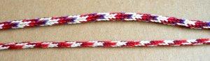 Two 'Doug's Braids' - 7-loop round spanish-type fingerloop braids, by loopbraider.com