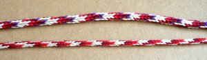 Two 'Doug's Braids' - 7-loop round spanish-type fingerloop braids, by loopbraider.com