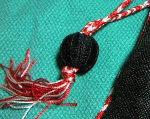 Julie's ball button on finger loop braid