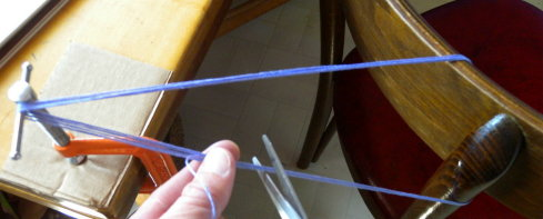 measuring out yarn for braiding, fingerloop braiding