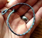 Chris Kurtonic, flat braid bracelet, 5 loops.