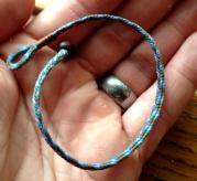 Chris Kurtonic, flat braid bracelet, 5 loops.