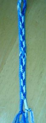 Dan Gaiser, bookmark. 8-loop flat double braid. Border made by color-linking.