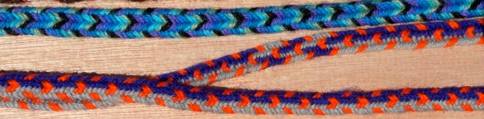 7-loop wool flat braids, one with color-linking (finger loop braiding)