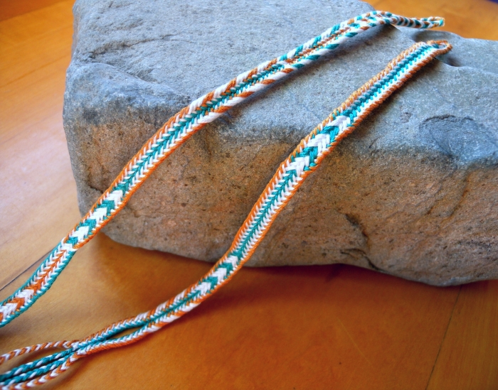 2 finger loop braids of 7 loops with multiple patterns created by linking loops of different colors