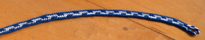 7-loop braid, navy and white. Loop manipulation braiding/ fingerloop braiding