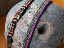 Two loop braids showing variations of the same color-linking pattern