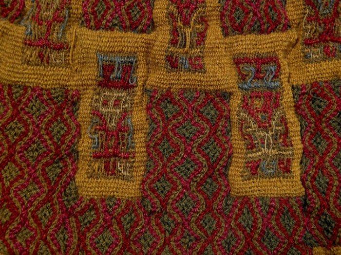 precolumbian textile pendant, braided and woven fabric
