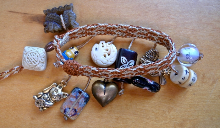 fingerloop braided bracelet with charms and beads