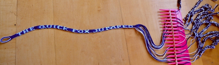 In-progress loop-braided letterbraid from the Nun's Book