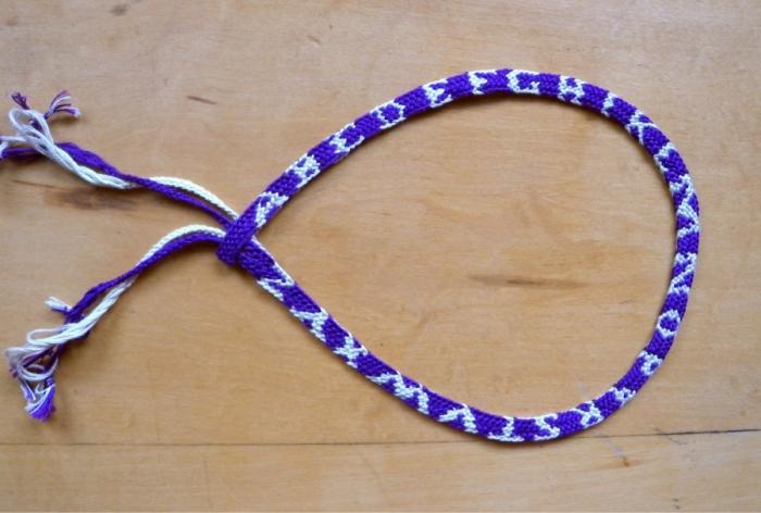 fingerloop braid sample of the Nun's Book letterbraid's alphabet