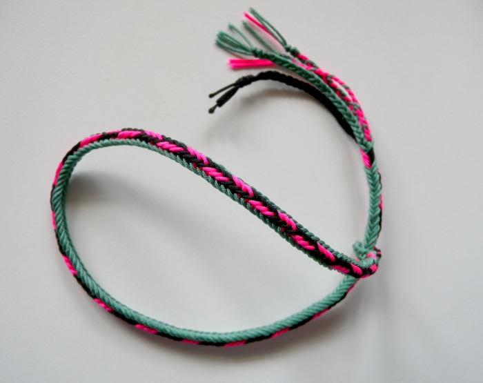 Unorthodox 7-loop braid, showing flat lower surface and rounded upper surface. (made with Chinese knotting cord)