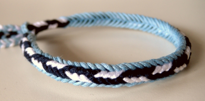 Bracelet made with unorthodox fingerloop braid of 7 loops, half the strands of waxed cotton cord
