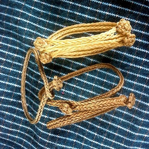 fingerloop braided bracelets by Dominic Taylor, waxed leatherworking thread