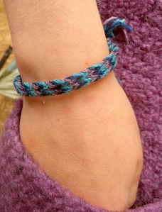 Fingerloop braiding, 6-loop flat braid by Hannah