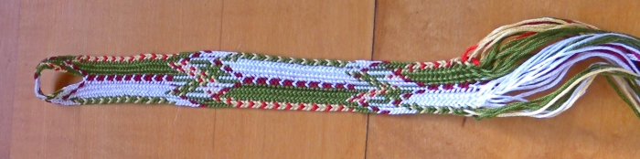 22 loops (44 strands), 3rd fingerloop braiding attempt at Itsukushima braid. Edge columns should not cross through center of red diamond!