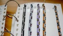 Triangular fingerloop braids of 9 and 7 loops
