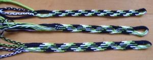 Multi-colored 50-50 zig-zag patterns in a 9-loop flat 'square' braid, and 8- and 10-loop flat double braids, fingerloop braids by Ingrid Crickmore, loopbraider.com