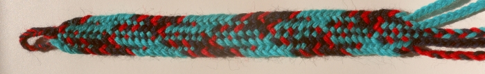 Replica of Iron Age fingerloop braid from Hallstatt Salt Mines, HallTex 301, color pattern as shown in schematic diagrams of study. Wool weaving yarn. loopbraider.com